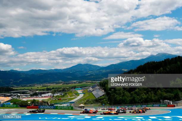 Mercedes' British driver Lewis Hamilton leads from the pole position at the start of the the Formula One Styrian Grand Prix race on July 12, 2020 in...