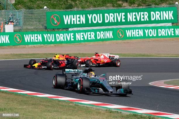 Mercedes' British driver Lewis Hamilton leads Red Bull's Dutch driver Max Verstappen and Ferrari's German driver Sebastian Vettel during the Formula...