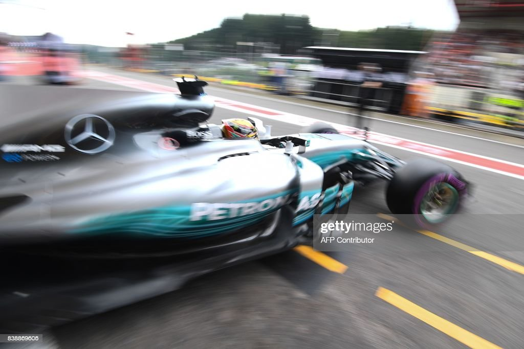 TOPSHOT - Mercedes' British driver Lewis Hamilton leaves the pits for the second practice session at the Spa-Francorchamps circuit in Spa on August 25, 2017 ahead of the Belgian Formula One Grand Prix. / AFP PHOTO / Emmanuel DUNAND