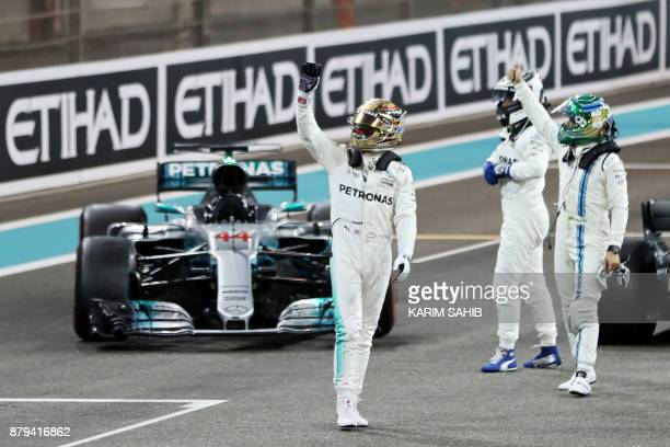 Mercedes' British driver Lewis Hamilton Mercedes' Finnish driver Valtteri Bottas and Williams' Brazilian driver Felipe Massa celebrate at the end of...