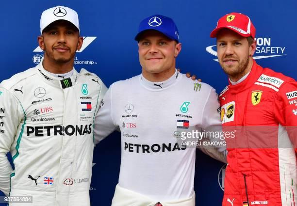 Mercedes' British driver Lewis Hamilton Mercedes' Finnish driver Valtteri Bottas and Ferrari's German driver Sebastian Vettel pose after the...