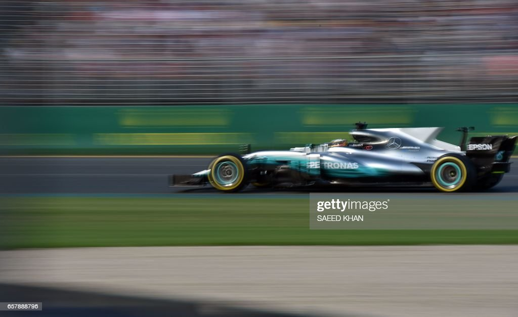 TOPSHOT - Mercedes' British driver Lewis Hamilton powers his car at the Australian Grand Prix in Melbourne on March 26, 2017. /