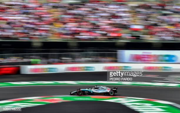 TOPSHOT Mercedes' British driver Lewis Hamilton powers his car during the F1 Mexico Grand Prix at the Hermanos Rodriguez circuit in Mexico City on...
