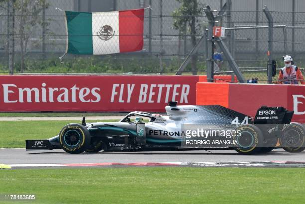 Mercedes' British driver Lewis Hamilton powers his car during the F1 Mexico Grand Prix at the Hermanos Rodriguez racetrack in Mexico City on October...