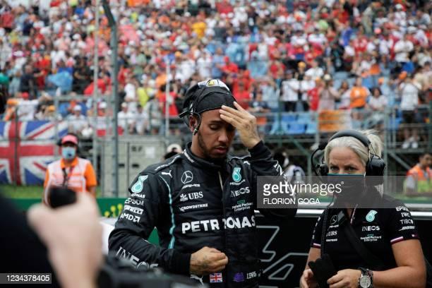 Mercedes' British driver Lewis Hamilton prepares ahead of the Formula One Hungarian Grand Prix at the Hungaroring race track in Mogyorod near...