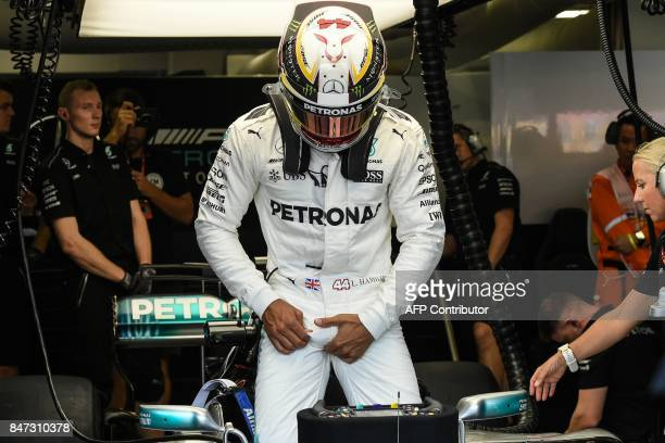 TOPSHOT Mercedes' British driver Lewis Hamilton prepares to sit in his car during the first practice session of the Formula One Singapore Grand Prix...
