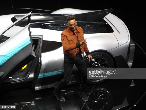 Mercedes' British driver Lewis Hamilton presents a Mercedes AMG Project One car during a preview night for the media on the eve of the opening of the...