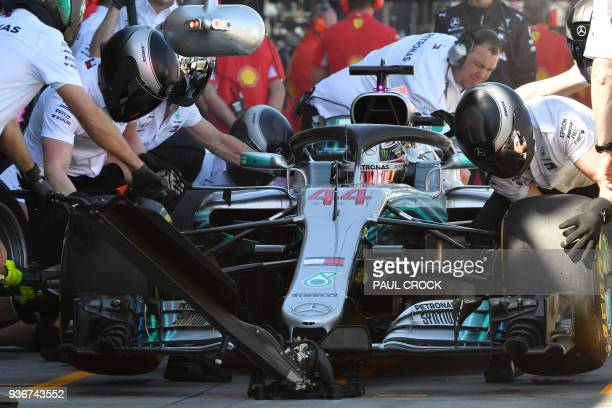 Mercedes' British driver Lewis Hamilton pulls in for a tyre change during the first Formula One practice session in Melbourne on March 23 ahead of...