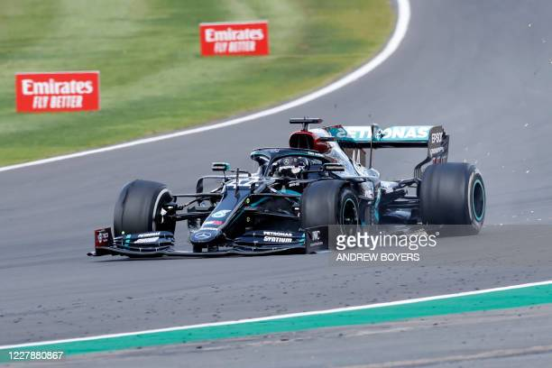 Mercedes' British driver Lewis Hamilton punctures near the finish of the Formula One British Grand Prix at the Silverstone motor racing circuit in...