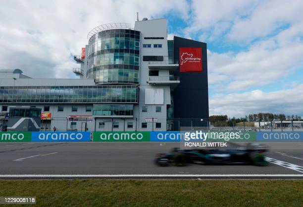 Mercedes' British driver Lewis Hamilton races during the German Formula One Eifel Grand Prix at the Nuerburgring circuit in Nuerburg, western...