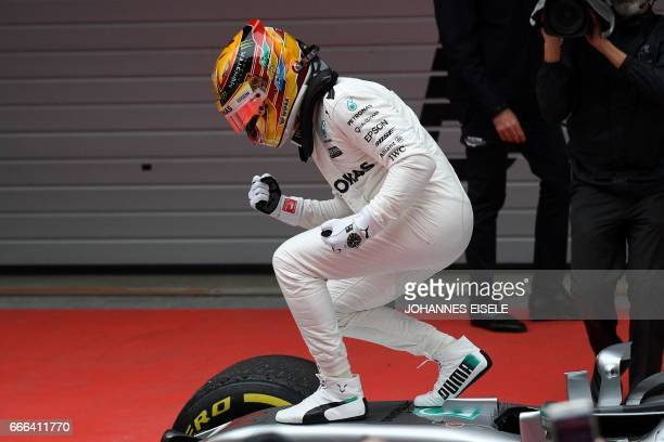 Mercedes' British driver Lewis Hamilton reacts after winning the Formula One Chinese Grand Prix in Shanghai on April 9 2017 / AFP PHOTO / Johannes...