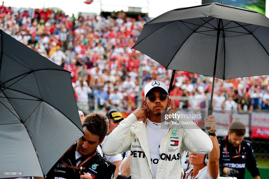 TOPSHOT - Mercedes' British driver Lewis Hamilton reacts ahead of the Formula One Hungarian Grand Prix race at the Hungaroring circuit in Mogyorod near Budapest, Hungary, on July 29, 2018.