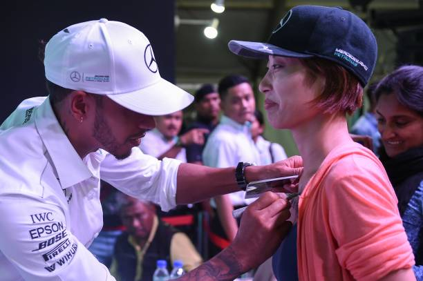 Mercedes british driver lewis hamilton signs autographs during a mercedes british driver lewis hamilton signs autographs during a meet the fans session in kuala m4hsunfo