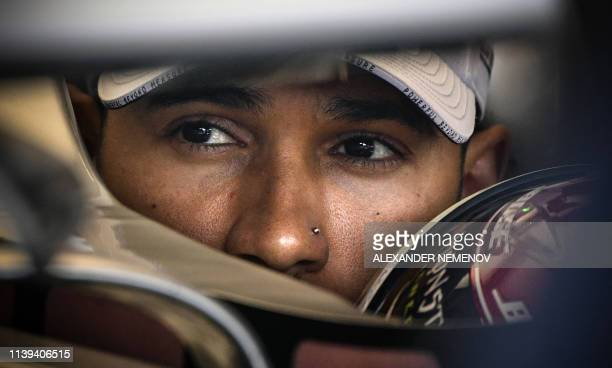 TOPSHOT Mercedes' British driver Lewis Hamilton sits in his car in the pits for the first practice session at the Baku City Circuit in Baku on April...