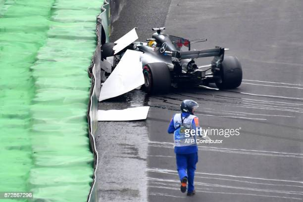 TOPSHOT Mercedes' British driver Lewis Hamilton sits in his car right after crashing during the Brazilian Formula One Grand Prix Q1 qualifying...