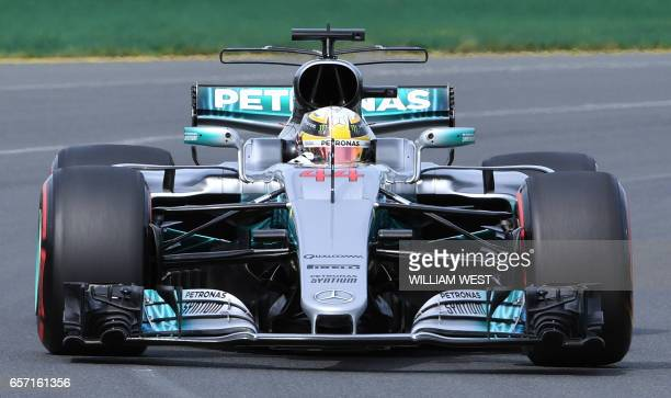 Mercedes' British driver Lewis Hamilton speeds through a corner during the second practice session at the Formula One Australian Grand Prix in...