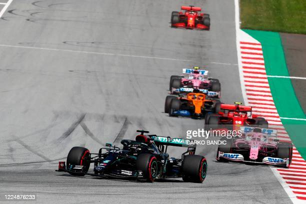 Mercedes' British driver Lewis Hamilton steers his car ahead of Racing Point's Mexican driver Sergio Perez during the Austrian Formula One Grand Prix...