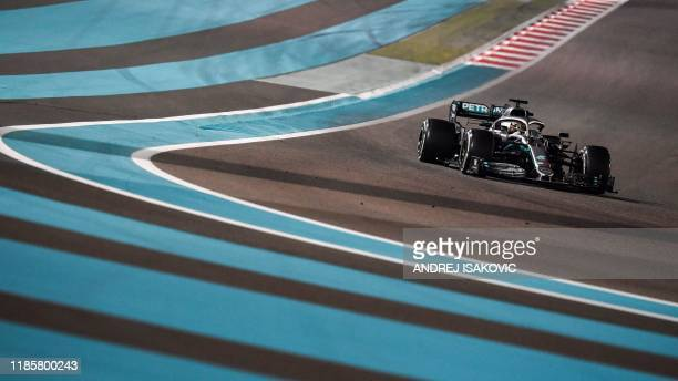 Mercedes' British driver Lewis Hamilton steers his car at the Yas Marina Circuit in Abu Dhabi, during the final race of the Formula One Grand Prix...