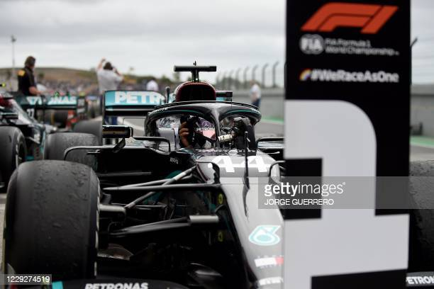 Mercedes' British driver Lewis Hamilton steers his car back to the parc ferme after the Portuguese Formula One Grand Prix at the Autodromo...