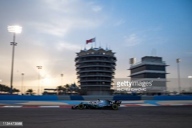Mercedes' British driver Lewis Hamilton steers his car during private tests at the Sakhir circuit in the desert south of the Bahraini capital Manama,...