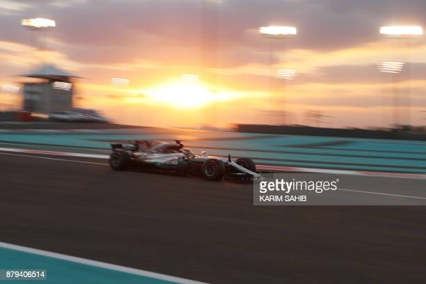 TOPSHOT Mercedes' British driver Lewis Hamilton steers his car during the Abu Dhabi Formula One Grand Prix at the Yas Marina circuit on November 26...