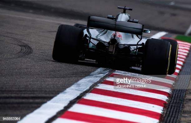 TOPSHOT Mercedes' British driver Lewis Hamilton steers his car during the first practice of the Formula One Chinese Grand Prix in Shanghai on April...
