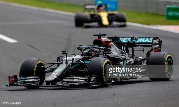 Mercedes' British driver Lewis Hamilton steers his car during the Formula One Hungarian Grand Prix race at the Hungaroring circuit in Mogyorod near...