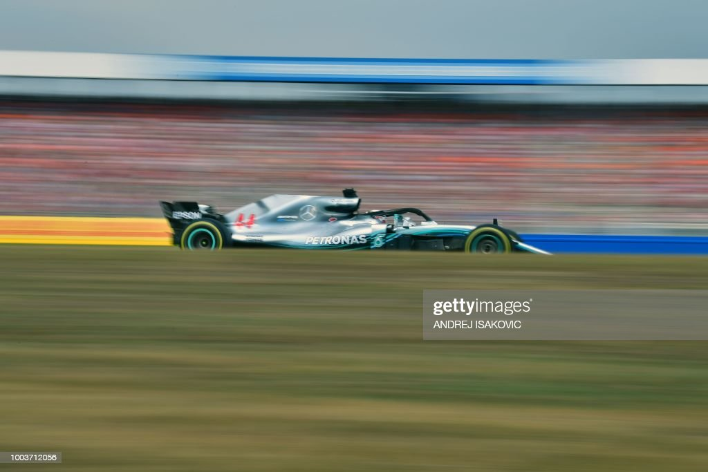 TOPSHOT - Mercedes' British driver Lewis Hamilton steers his car during the German Formula One Grand Prix at the Hockenheim racing circuit on July 22, 2018 in Hockenheim, southern Germany.