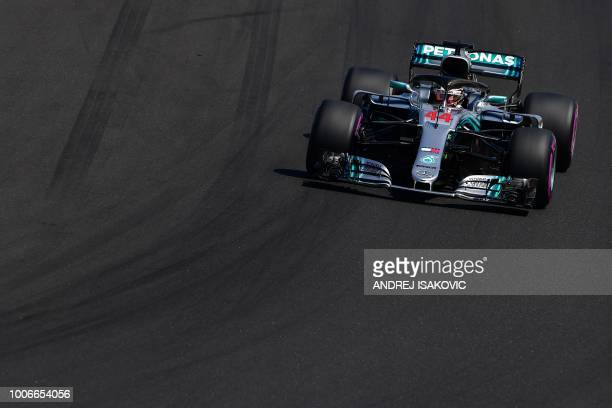 TOPSHOT Mercedes' British driver Lewis Hamilton steers his car during the third free practice session ahead of the Formula One Hungarian Grand Prix...