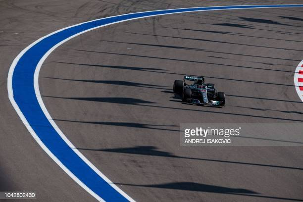 Mercedes' British driver Lewis Hamilton steers his car during the third practice session of the Formula One Russian Grand Prix at the Sochi Autodrom...