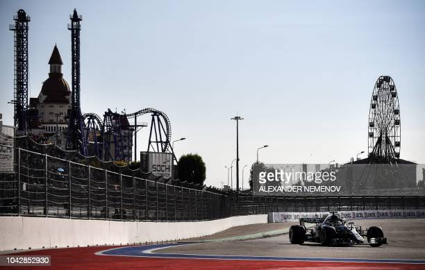 Mercedes' British driver Lewis Hamilton steers his car during the qualifying session for the Formula One Russian Grand Prix at the Sochi Autodrom...