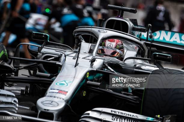 Mercedes' British driver Lewis Hamilton steers his car during the first practice session of the Formula One Hungarian Grand Prix at the Hungaroring...