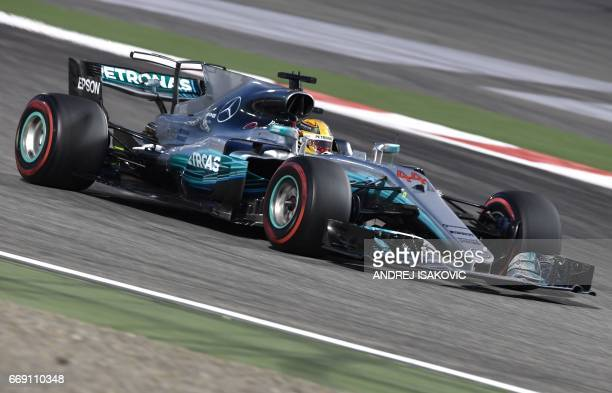 Mercedes' British driver Lewis Hamilton steers his car during the Bahrain Formula One Grand Prix at the Sakhir circuit in Manama on April 16 2017 /...