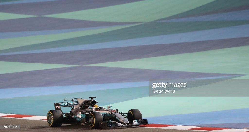 Mercedes' British driver Lewis Hamilton steers his car during the Bahrain Formula One Grand Prix at the Sakhir circuit in Manama on April 16, 2017. /