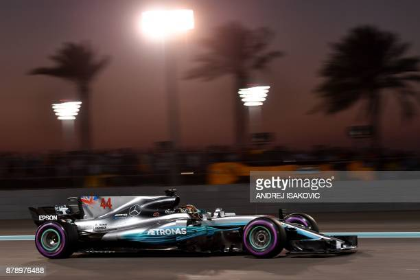 TOPSHOT Mercedes' British driver Lewis Hamilton steers his car during the qualifying session ahead of the Abu Dhabi Formula One Grand Prix at the Yas...