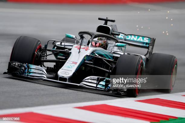 TOPSHOT Mercedes' British driver Lewis Hamilton steers his car during the first practice session ahead of the Austrian Formula One Grand Prix in...