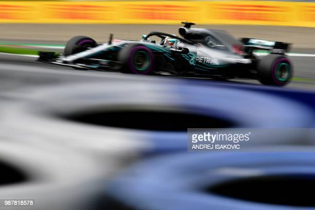 Mercedes' British driver Lewis Hamilton steers his car during the third practice session ahead of the Austrian Formula One Grand Prix in Spielberg...