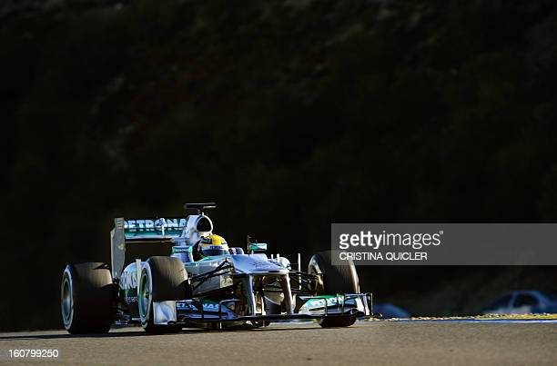 Mercedes' British driver Lewis Hamilton steers his Formula One during the second day of testing at Jerez racetrack on February 6 2013 in Jerez de la...