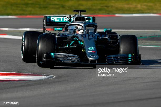Mercedes' British driver Lewis Hamilton takes part in the tests for the new Formula One Grand Prix season at the Circuit de Catalunya in Montmelo in...