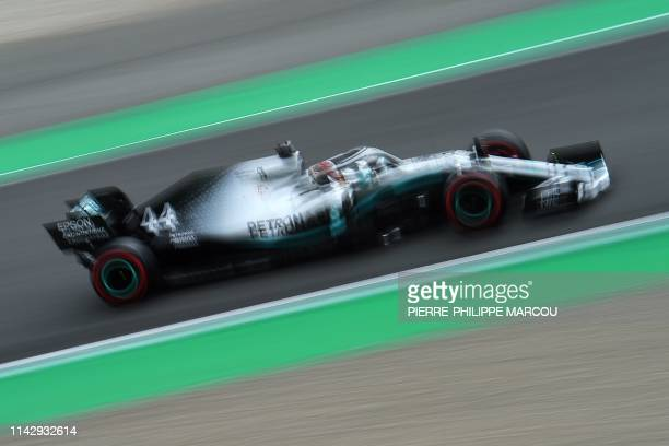Mercedes' British driver Lewis Hamilton takes part in the third practice session at the Circuit de Catalunya in Montmelo in the outskirts of...