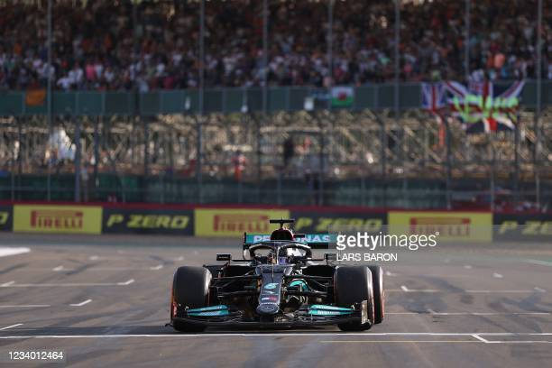 Mercedes' British driver Lewis Hamilton takes pole position after the sprint race qualifying session ahead of the Formula One British Grand Prix at...