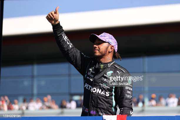 Mercedes' British driver Lewis Hamilton waves after the sprint session of the Formula One British Grand Prix at the Silverstone motor racing circuit...