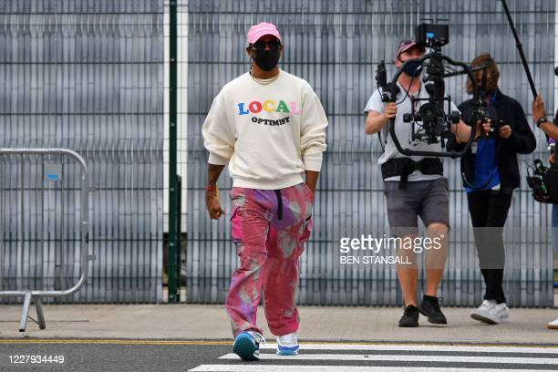 Mercedes' British driver Lewis Hamilton wearing a protective face mask arrives ahead of previews for the F1 70th Anniversary Grand Prix at...