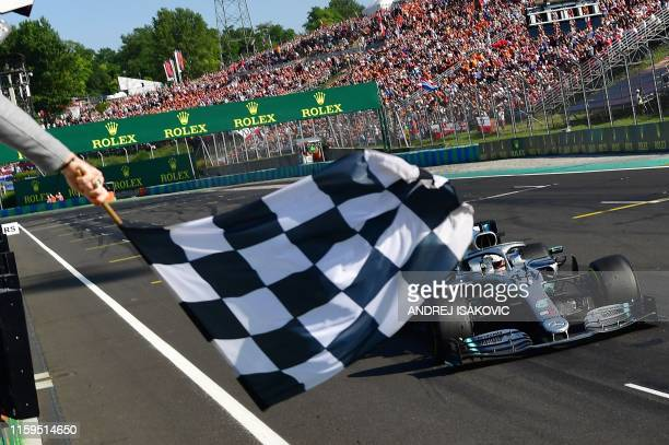 TOPSHOT Mercedes' British driver Lewis Hamilton wins the Formula One Hungarian Grand Prix at the Hungaroring circuit in Mogyorod near Budapest...