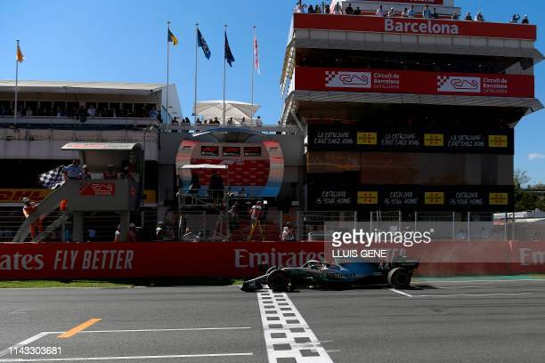 Mercedes' British driver Lewis Hamilton wins the Spanish Formula One Grand Prix at the Circuit de Catalunya in Montmelo in the outskirts of Barcelona...