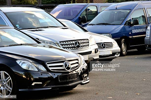 Mercedes cars under seals are parked and secured by French gendarmes on September 29 2012 in Villeneuved'Ascq northern France four days after the...