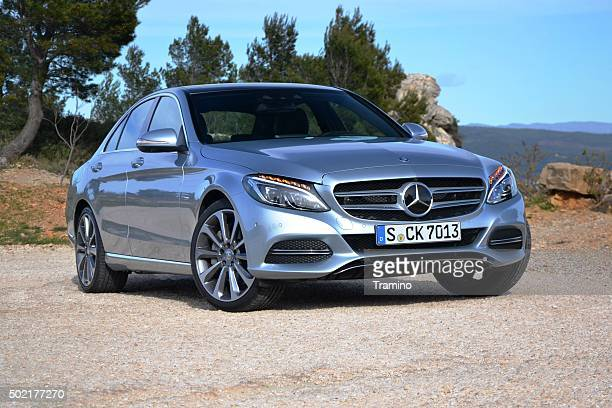 mercedes c-class stopped on the road - mercedes stock photos and pictures