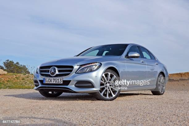 mercedes c-class stopped on the road - mercedes benz s class stock photos and pictures
