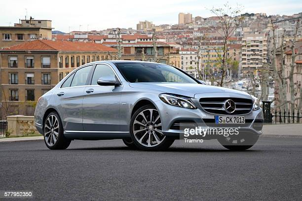 mercedes c-class stopped on the street - mercedes stock photos and pictures