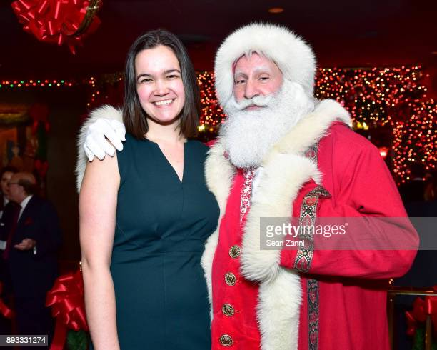 Mercedes De Guardiola and Santa Claus attend A Christmas Cheer Holiday Party 2017 Hosted by George Farias and Anne and Jay McInerney at The Doubles...